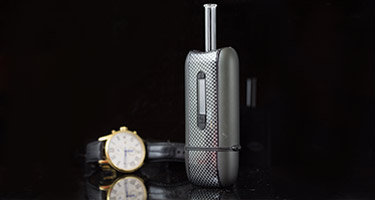 Carbon fiber DaVinci Ascent vaporizer with fashionable watch