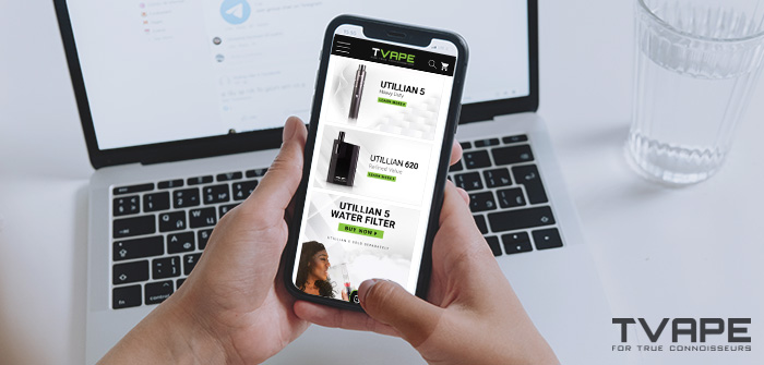Mobile phone in hands with vaporizer retailer